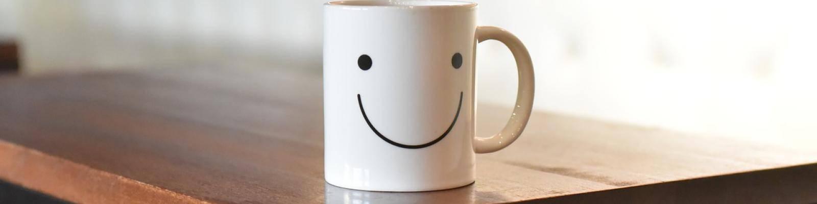 Mok met blije smiley