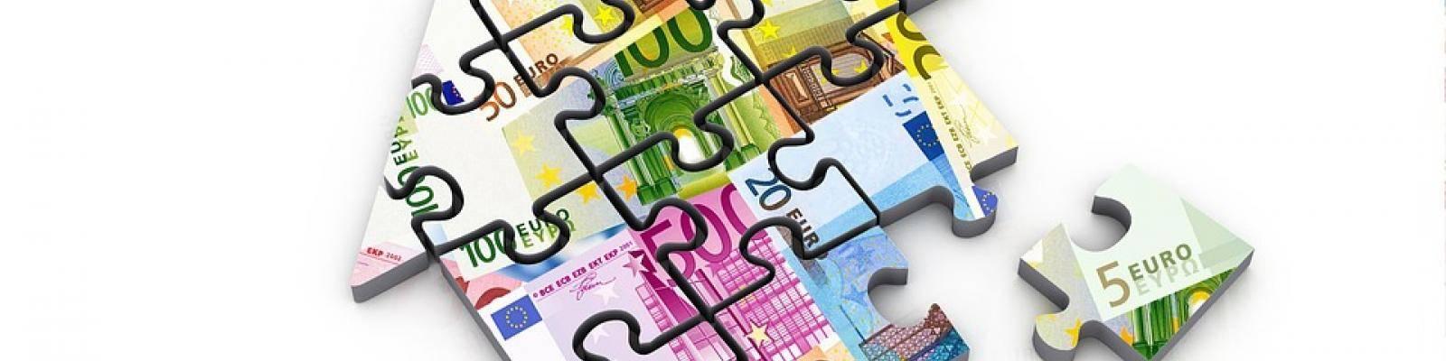 Puzzel huis geld